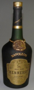 Napoleon on the shoulder (without accent), Bras d'Or in big letters. Alcohol percentage and content stated differently