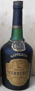 Napoleon on the shoulder (without accent). Napoleon stated on main label. Brownish label. Text underneath 'cognac' differs.