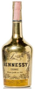 Gold bottle with paper label below and '190' on the shoulder