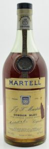 Capped cork, no riveting; fine liqueur cognac brandy stated; 24 fl ozs stated; rather yellow label