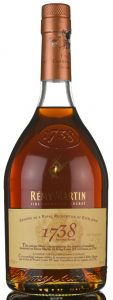 "Different text (in two languages): ""This unique blend commemorates the reward of excellence bestowed on Rémy Martin by King Louis XV of France, in 1738""; 70cl"