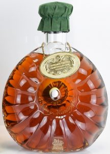With a see through sticker stating content 70cl and ABV differently