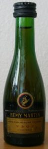 brown label, clear green glass; number very vague diagonal on left side of the label; screw cap