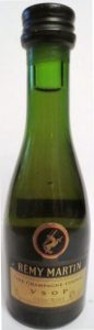 brown label, clear green glass; 'cognac france' is less wide; number very vague diagonal on left side of the label; screw cap