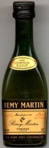 Text in red in upper left and stamp in red in uper right corner. Underneath: 'tres rare fine champagne'.