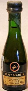 brown label, clear green glass; number on the black part underthe brown part of the label'; 3cl stated