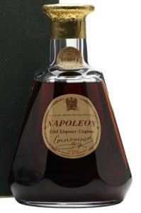 With old liquor cognac on it and 70 proof in the middle below; old cap