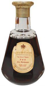 VOC Fine Champagne; 4/5 quart. With the sentence: 'all Courvoisier cognac bears the registered phrase'