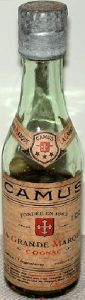 Different colour of glass and different cap. On label it says: produce of France just below and to the right of 'Cognac'