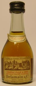 Clear glass; crescent shaped neck label