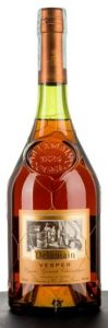 Label orange with Delamain in brown-golden space, 700ml