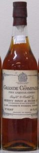 Grande Champagne fine liqueur cognac; 70% proof; 68cl, both sitting near the edge; brown cap