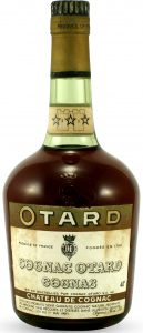 With a castle on the neck label; Otard on a green band