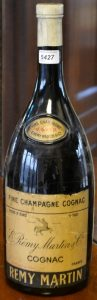 70 Proof stated; content not stated, called a large magnum at auction. Probably 3L.