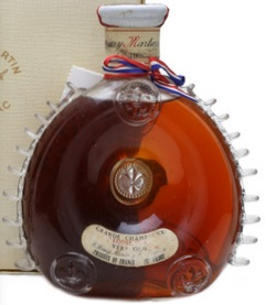 'Very Old' with 70 proof stated; 0.7L on the bottom and 24 FL OZ on the back of the neck; no number; white carton box (1962-63); there is a modern centaure on top of the capsule.
