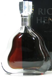 70cl stated at the back; with a paper duty seal and a number in blue on the back of the neck