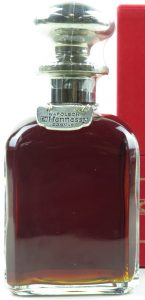 Napoleon Silver Top decanter, content not stated, said to be 70cl on auction