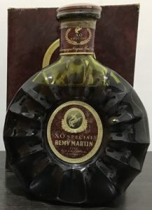 70cl (not stated) in dark green glass; XO Special is printed above Remy Martin. 1980s