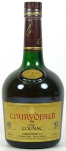 With a yellow-gold label in the shoulder blob, label itself very yellow too; 70 cl stated