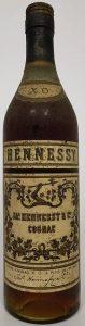 text: 'Notre cognac X. O. a plus de 45 ans'; different capsule (crimped)