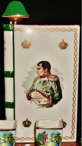 Napoleon Castel limoges, green bands on the back are less massive; Castel logo has the name Castel stated; difference with previous: the way the laurels touch in the corners