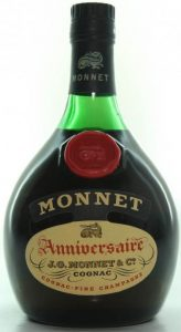 No content or ABV stated; Anniversaire in large print; Monnet-part is attached to main label