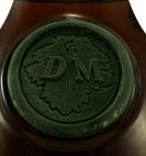 DM on a grape leaf; DM: Denis-Mounié; used on Edward VII and several other bottles