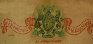 By appointment to H.M. King George V on a banner and with their coat of arms