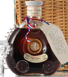 Grande champagne very old age unknown (no mentioning of Louis XIII); royal banquet card of 1957; rattan basket (prob 1961)