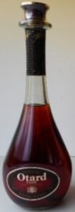 Neck capsule is straight; 70cl stated with Asian text on a red-orange label; on the back-side also Asian text