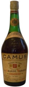 No text left or right of the Camus embleme; neck label in English and 70% Proof on bottom of label.