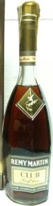 70cl; Remy Martin on a green background; one line below 'Club de Remy Martin'; with a paper duty seal on top