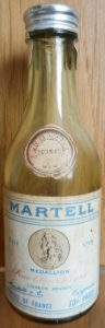 70 Proof; and liqueur brandy instead of fine champagne. Note: medallion in stead of medaillon