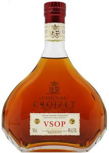 On the neck is an emblem; 700ml and 40%ALC/VOL stated and a signature on the label itself
