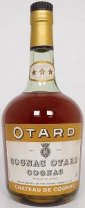 With a castle on the neck label; the neck label has an oval shape; Otard and Chateau de Cognac on brown bands