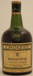 1914 fine champagne cognac; dumpy bottle