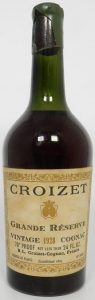 1928 grande reserve vintage cognac, tapered bottle; with 70° Proof and 'not less than 24 FL.OZ' stated (est. 1960s)