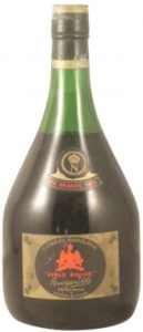 With a paper shoulder label; 0,7L; Brugerolle is embossed on the glas below the label