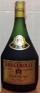 VSOP Fine champagne; 70cl and 40° stated; Brugerolle in red; neck label black, red and gold; with a paper duty seal on top