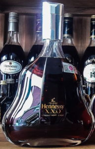 1L XXO, cognac hors d'age on one line and a duty not paid sticker