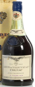 75 Years old, fine champagne; blue emblem on shoulder; punctured code through the eagle