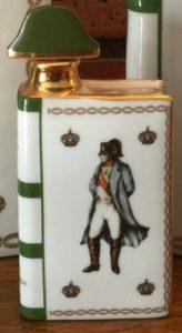 Laurels on just three sides around Napoleon. Below on back it says: Camus Grande Marque Cognac.