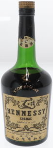With a Japanese label on the neck and Japanese characters underneath on the main label (700ml)