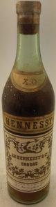 text: 'Notre cognac X. O. a plus de 45 ans' and 'cette bouteille ne doit pas être revendue hors de France' (1940s)
