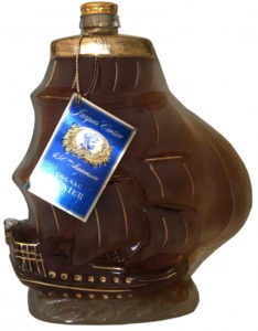 Galleon, text on label: Jacques Cartier 450eme anniversaire Cognac Prunier Cognac Galion Galleon Extra 700 ml Product of France 40% alc/ vol Bottled and shipped by Maison Prunier S. A. Cognac , France (1980s)