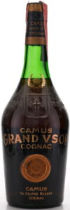 Text on glass in different order: first Camus, then GRAND VSOP, then cognac; with a cross on the glass