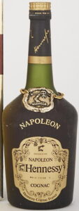 Napoleon on the shoulder (without accent), Bras d'Or in small letters; with a bottle number printed