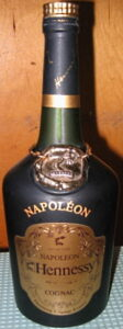 Napoléon on the shoulder (with accent), Bras d'Or in small letters; with a bottle number printed