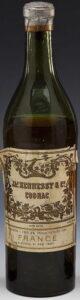 Early USA import bottle; contents 1 pint 8 3/4 fluid oumces net.; alcohol 45 per cent (est. 1920s) (shoulder label has come off?)