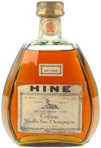 Neck label with the royal arms; HINE in bold black letters on top; 'Cognac Vieille Fine Champagne' stated (1970s)